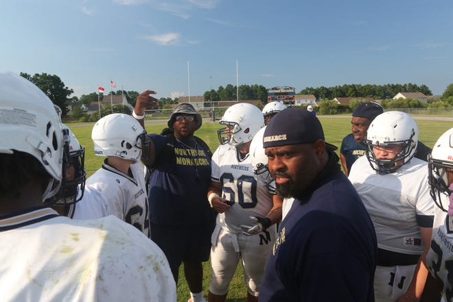 Northside coach Kendrick Pollock talks to his team Friday at the Marine Federal Credit Union Football Jamboree.