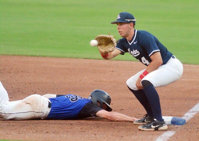 Lonestar Baseball first baseman Max Puls takes a pickoff throw as Cheney Diamond Dawg Jaxson Syring slides back to base. Puls plays for Texas A&M-Corpus Christi.