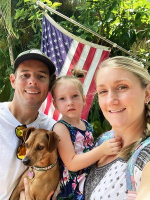 The Charrons — Gabriel, 2-year-old Mikayla and France — with the family pooch, a chihuahua and dachshund mix.