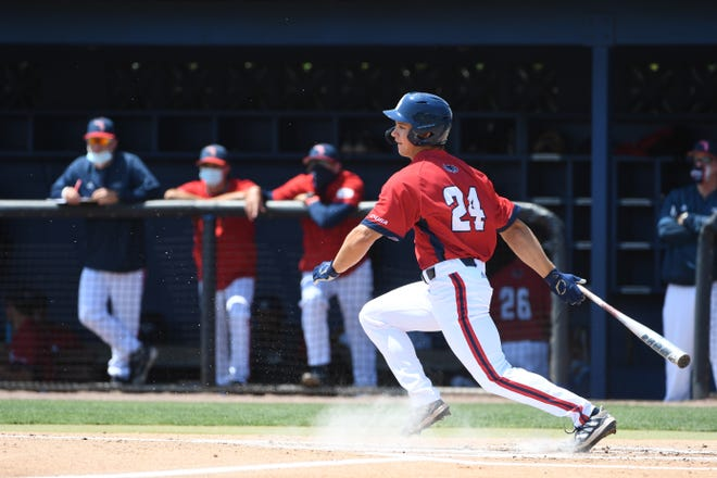 Mitchell Hartigan, lining a hit against Old Dominion last season, will return for another season while starting work on his masters.