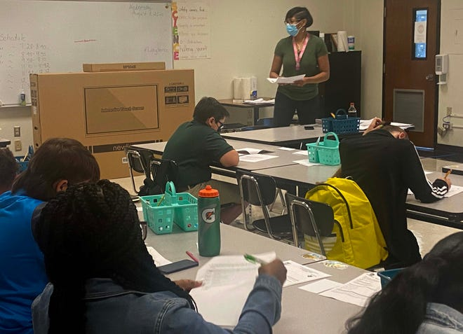 Plaquemine High School teacher Renita Whitaker speaks with her seventh-grade class during opening.