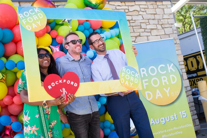 Rockford resident Ross Ticknor, center, poses for a portrait with Mayor Tom McNamara, right, and 12th Ward Alderwoman Gina Meeks with a promotional frame for Rockford Day 2021 at Rockford City Market Friday, Aug. 13, 2021, in Rockford.