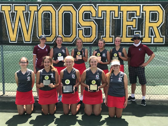 The Dover girls tennis team defended its title at the Orrville Invitational held at the College of Wooster on Saturday.