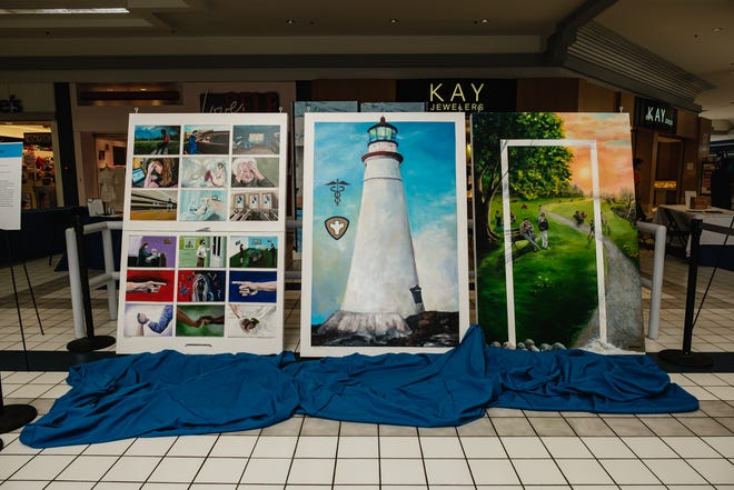Murals created by artists Lynn Fraelich and Carole Hunt are displayed at New Towne Mall in New Philadelphia. The works are dedicated to Tuscarawas County residents who lost their lives to COVID-19, and to the front-line workers who took care of the community.