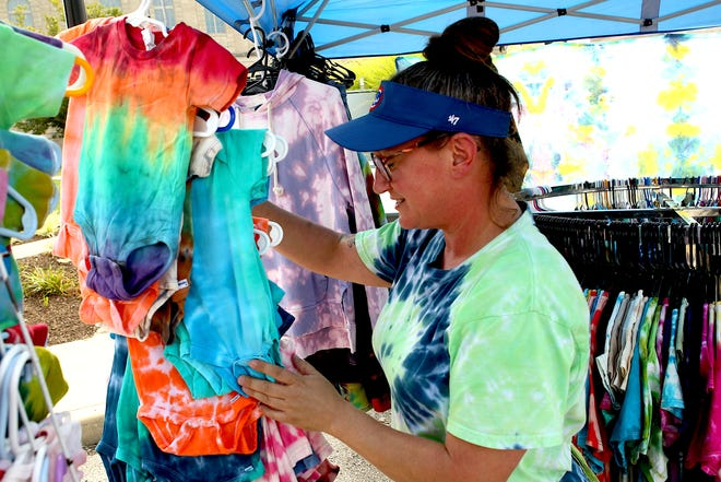 Homegrown Handies vendor Heather O' Connor arrainges her inventory during the Bedford Farmers Market Saturday. The market is open Saturday mornings through the end of October. Any questions can be answered by Allison Roodschild, 812  276-5632.