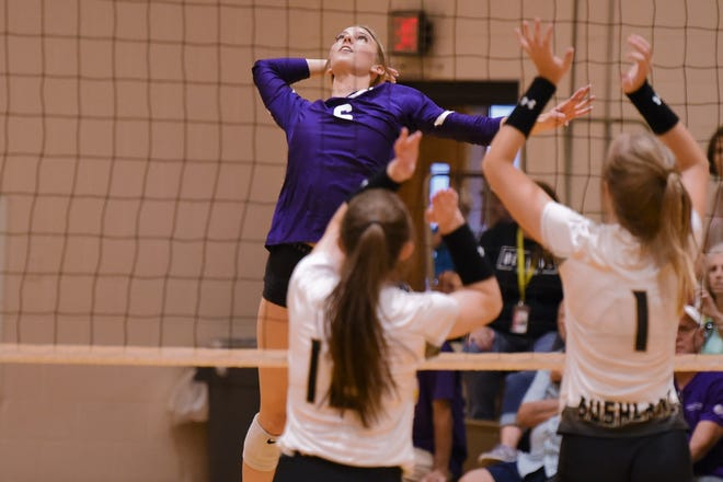 Wylie's Jaron McAden (6) goes up for a kill against Bushland during Friday's Gold Pool play of the Bev Ball Classic at the Abilene High auxiliary gym on Aug. 13, 2021.