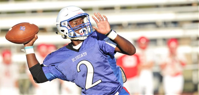 Coleman quarterback Jadin Jackson, a sophomore, prepares to throw a pass against Albany during a scrimmage Friday at Hufford Field in Coleman.