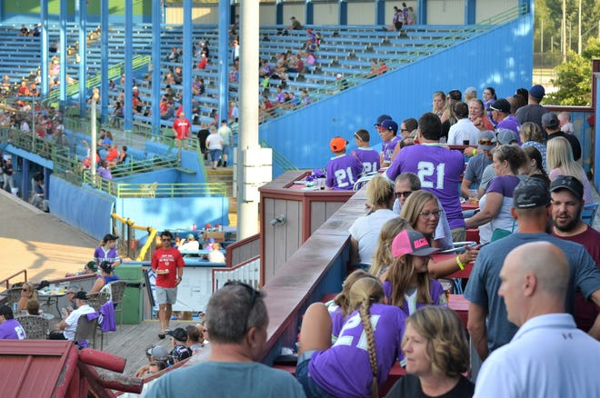 A Friday night crowd, with a crowded 'Party Deck' watches the 2021 Battle Creek Bombers during the final weekend of the season.