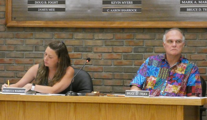 Bruce Truka, R-First Ward and council president pro tempore, listens to discussion during Friday night's special meeting of Bucyrus City Council. Council clerk Rebecca Warren is at left.