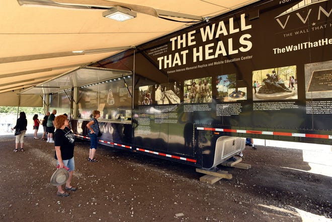 At a trailer near the Vietnam Veterans Memorial replica, visitors are given details about the actual memorial in Washington, D.C., as well as other facts about the Vietnam War.