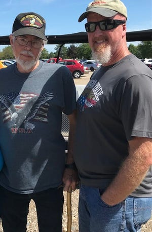 Vietnam veteran Joe Conrad, 80, of Flat Rock, with his son-in-law Richard Ernest, 51, an Iraq veteran from Brownstown, visited the Memorial in Riverview on Saturday.