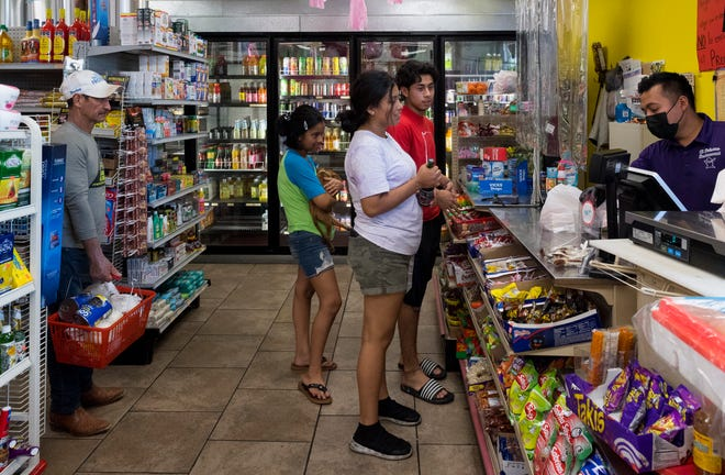 Customer Andrea Velasquez, center, purchases fresh al pastor from El Paisano Mexican Store and Taqueria off South Green River Road Friday afternoon, Aug. 13, 2021.