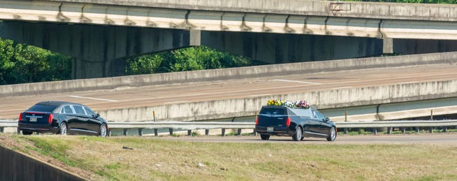 A funeral procession for late Hinds Co. Sheriff Lee Vance as it proceeds through Jackson, Miss. Aug.14, 2021.