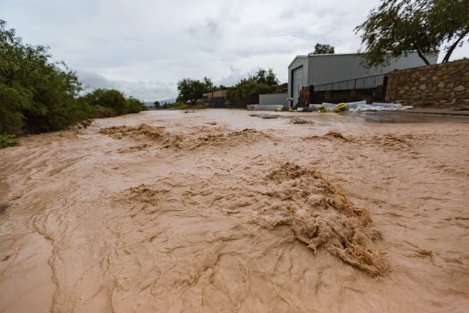 Water flows though the streets after heavy rain and flooding in La Union on Saturday, Aug. 14, 2021.