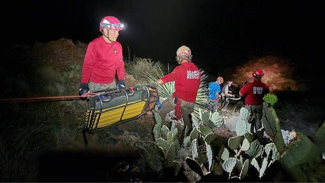 Search and rescue organizations work on Tonuco Mountain between Radium Springs and Rincon overnight Tuesday, Aug. 10, to recover a woman's body.