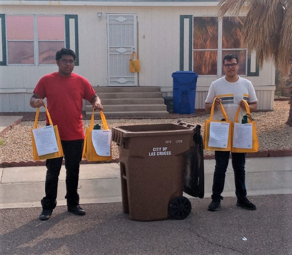 Left to right, Doña Ana County interns Michael Carrillo and Joel Gonzales are pictured delivering educational material to LCU customers in Las Cruces.