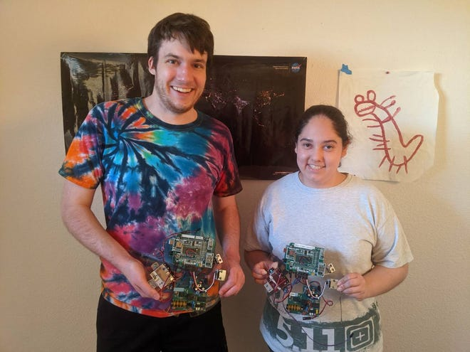 Atomic Aggies team members David Fricke and Anita Jimenez hold the two RockOn! Mission payloads before they were sent to Colorado for inspection. One of the payloads was launched in June and the second will be launched in September onboard a high-altitude rocket.