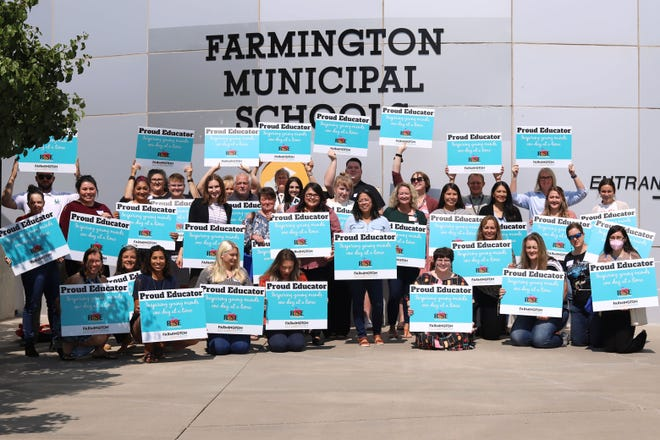 An Aug. 5 photo shows first year teachers for Farmington Municipal Schools preparing for the new school year outside district offices at the 30th Street Education Center in Farmington. A new grant will help district officials build stronger ties with the community and help bring more teachers into the classroom.