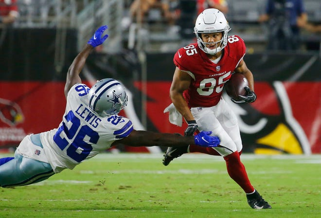 August 13, 2021; Glendale, Arizona, USA; Cardinals' Rondale Moore (85) breaks a tackle from Cowboys' Jourdan Lewis (26) after a reception during the first quarter at the State Farm Stadium in Glendale. Patrick Breen-The Republic