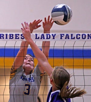 Olivia Abbott, left, blocks a shot for Veribest during the Falcon Fest Volleyball Tournament in Veribest on Saturday, Aug. 14, 2021.