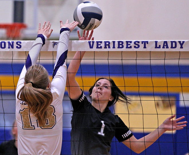 Kylie Bradley (1), center, tries to tap the ball over the net for Water Valley while Kamri Marler (18), left, tries to block the shot for Sterling City during the Falcon Fest Volleyball Tournament in Veribest on Saturday, Aug. 14, 2021.