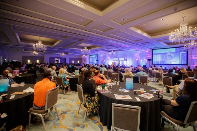 Tallahassee Chamber of Commerce annual conference attendees listen to speakers during the opening general session on Saturday, Aug. 14, 2021.