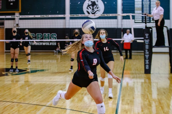 Vista Ridge setter Ryleigh Garis, trying to save a ball in a playoff match against Lake Travis last season, earned MVP honors while leading the Rangers to the Leander/Georgetown/East View tournament title Saturday.