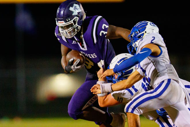 Thrall running back Tyreke Irvin runs right to evade Snook defenders during a game in the 2020 season. The Tigers hope to improve on last season's first-round playoff exit.