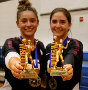 Austin High's Kasen Rosenthal, left, and sister Tanon Rosenthal proudly hold their trophies after winning the gold bracket at the Jason Landers Invitational volleyball tournament Saturday at the Delco Activity Center. Austin High beat Cibolo Steele to claim the trophy at the annual tournament that honors Landers, the former Bowie coach who died in 2014 after battling cancer.