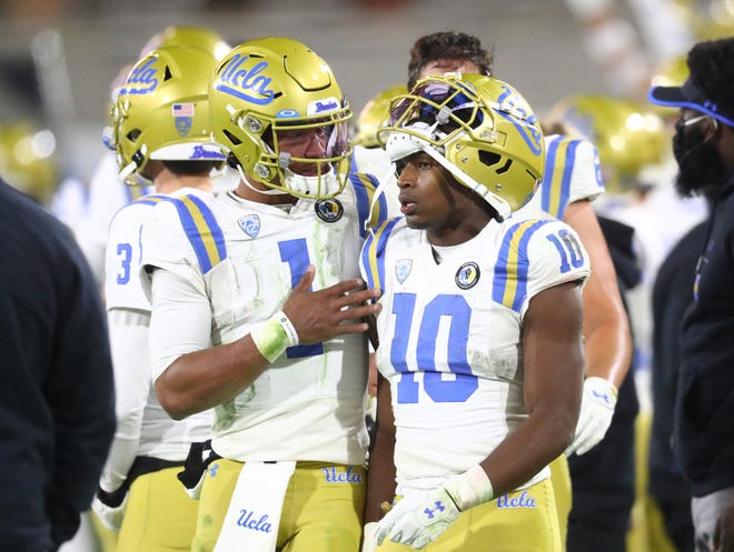 UCLA quarterback Dorian Thompson-Robinson, left, talks with running back Demetric Felton during last year's game at Arizona State. The Bruins have one of the most experienced rosters in the Pac-12 this year, something they hope will work to their advantage.