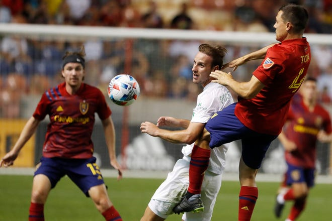 Austin FC midfielder Tomás Pochettino and Real Salt Lake defender Donny Toia battle for the ball in the second half of Saturday night's 1-0 Real Salt Lake win. Austin FC was shut out for the 11th time in its last 14 matches.