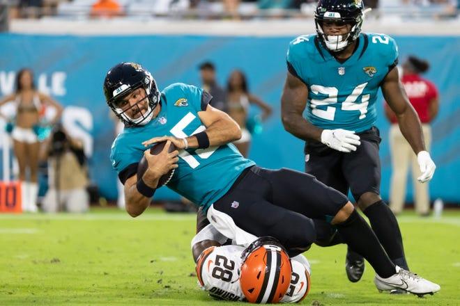 Browns linebacker Jeremiah Owusu-Koramoah sacks Jacksonville Jaguars quarterback Gardner Minshew during the Browns' 23-13 preseason win Saturday night in Jacksonville. [Matt Pendleton/USA TODAY Sports]