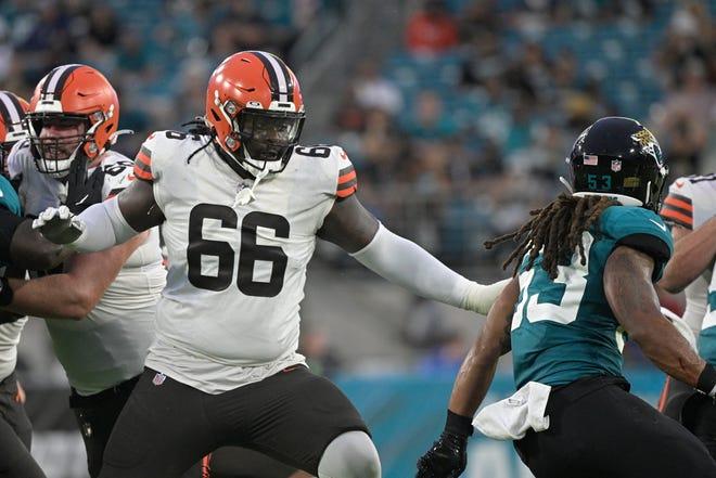 Browns offensive tackle James Hudson (66) looks to block Jacksonville Jaguars linebacker Dakota Allen, right, during the first half of an NFL preseason game. Phelan M. Ebenhack/Associated Press]