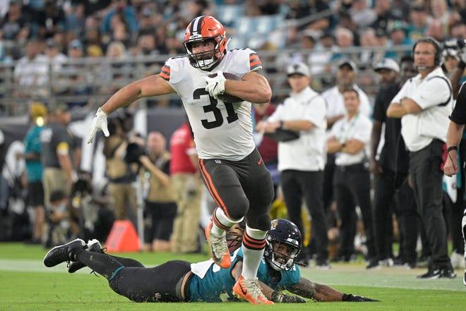 Cleveland Browns fullback Andy Janovich runs past Jacksonville Jaguars linebacker Dakota Allen during the first half of an NFL preseason football game, Saturday, Aug. 14, 2021, in Jacksonville, Fla. (AP Photo/Phelan M. Ebenhack)