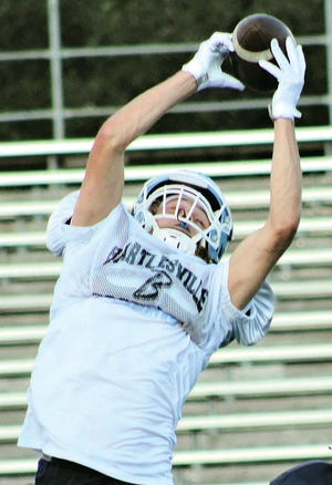 Bartlesville High School senior receiver Gage Keaton soars to make a grab out of the stratosphere during the intrasquad scrimmage Saturday evening at Custer Stadium.