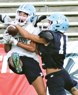 Bartlesville High freshman defensive back Noah Darnell, right, prevents a completion during intrasquad scrimmage action Saturday evening at Custer Stadium.