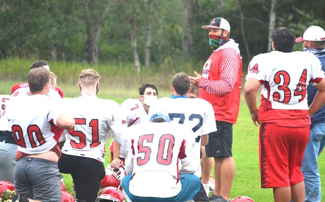 Onaway varsity football coach Steve Klinge talks to players during a practice from the 2020 season. The Cardinals went 6-1 overall and earned a share of the Ski Valley 8-Man championship last season.