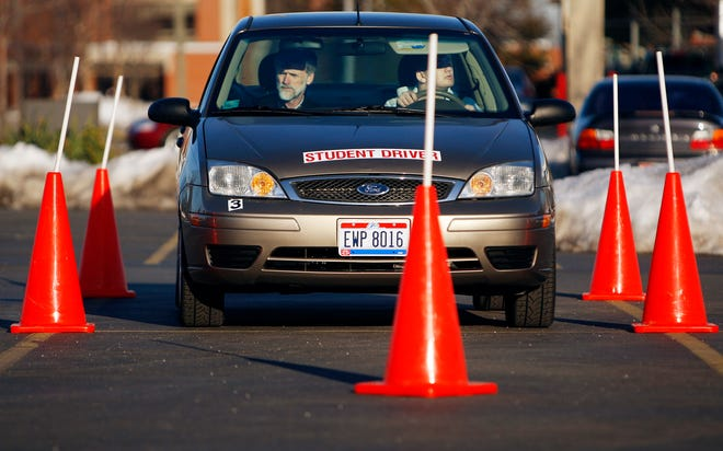 A student driver practices a maneuverability course in 2010.