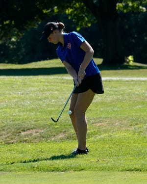 Lenawee Christian's Lauren Swiggum chips onto the green during a meet in the 2020 season.
