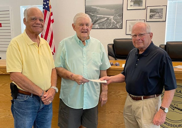 From left are former Mayor Johnnie Franzeskos, former Alderman Joe Barfield and Larry Shields, who received the final payment on the City Hall.