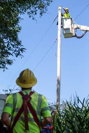 Consumers Energy crews work to restore electricity.