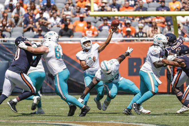Miami Dolphins quarterback Tua Tagovailoa (1) passes the ball during the first half of a preseason NFL football game against the Chicago Bears, Saturday, Aug. 14, 2021, in Chicago. (AP Photo/Kamil Krzaczynski)