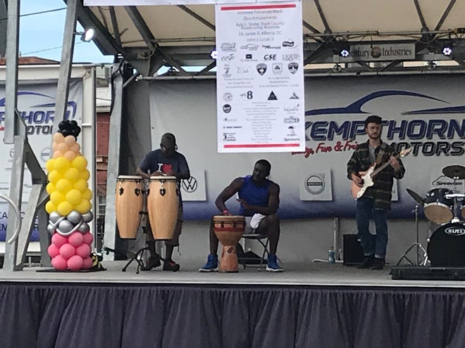 Local musicians Pach Atomz, Brent Walker Jr. and Solomon Unzicker play Sunday afternoon during the Welcome Back Community Extravaganza organized by A.S.P.I.R.E. Today. Not pictured is drummer, Brent Walker Sr. The event in downtown Canton was a chance for fun and for families to get school supplies.