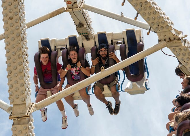 People ride the Freak Out ride at the Bolton Fair Sunday, Aug. 15.