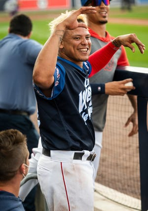 Yairo Muñoz is all smiles in the dugout Saturday after extending his hitting streak to 35 games.