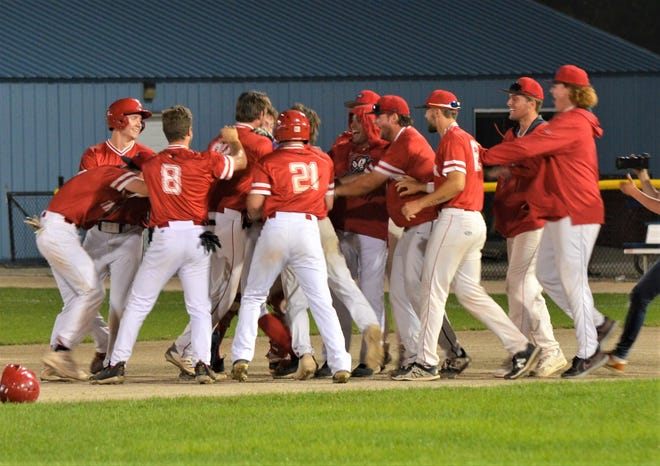 The Battle Creek Bombers celebrate a walk-off win in the final game of the regular season at C.O. Brown Stadium on Saturday.