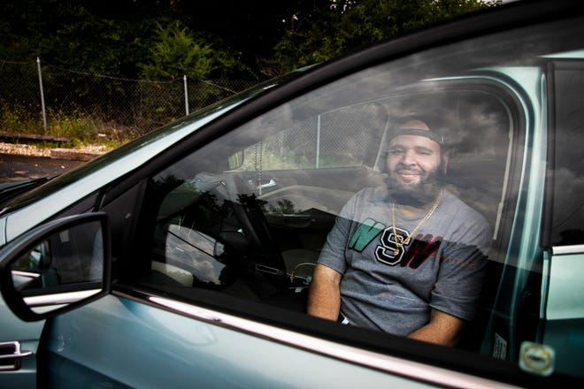 Peter LaFontaine sits in his car after visiting a dispensary in Madisonville on Friday, August 13. LaFontaine suffers from agoraphobia and related anxiety disorders and is currently using medical marijuana. He has greatly benefitted from  telemedicine allowances that have been in place since the pandemic began.