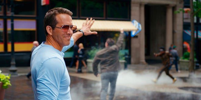 """Ryan Reynolds stars in """"Free Guy,"""" which took in $28.4 million on its opening weekend."""