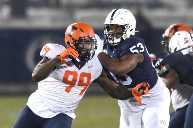 Penn State offensive lineman Rasheed Walker blocks Illinois defensive lineman Owen Carney Jr. (99) during an NCAA college football game in State College, Pa., on Saturday, Dec. 19, 2020. (AP Photo/Barry Reeger)