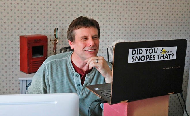 """FILE - This Sept. 25, 2018 file photo shows David Mikkelson, founder of Snopes, the site that tracks fakery on the web, in his home office in Tacoma, Wash. The co-founder, CEO and a major shareholder of the fact-checking site admitted to plagiarizing from dozens of articles done by mainstream news outlets over several years, calling the appropriations """"serious lapses in judgment."""" From 2015 to 2019, and possibly even earlier, Mikkelson included material lifted from the Los Angeles Times, The Guardian and others to scoop up web traffic, according to BuzzFeed News, which broke the story Friday, Aug. 13, 2021. (Greg Gilbert/The Seattle Times via AP, File)"""